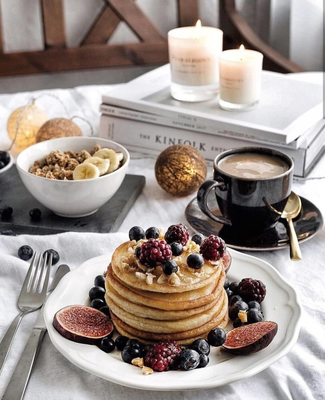 candles, pancake, coffee and books